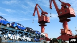 "Cars to be exported are seen at a port in Lianyungang in China's eastern Jiangsu province on May 31, 2018. A European Union official says the EU will not ""gang up"" with China against the United States, even if the trade group opposes America's protectionist policies. (AFP PHOTO)"