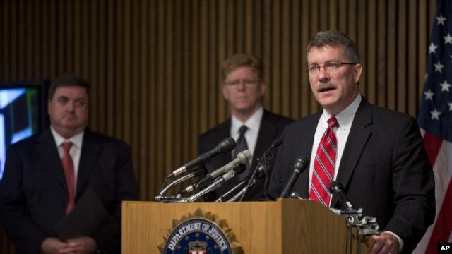 """Ron Hosko, assistant director of the FBI's Criminal Investigative Division, right, speaks about """"Operation Cross Country"""" during a news conference at FBI headquarters in Washington, July 29, 2013."""