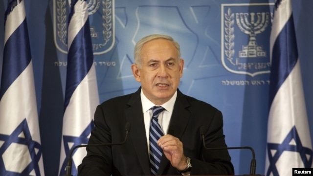 Israel's Prime Minister Benjamin Netanyahu gestures as he delivers a statement to the foreign media in Tel Aviv, November 15, 2012.