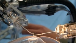 Robotic Device Small Enough to Operate on the Human Eye