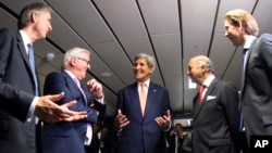 French Foreign Minister Laurent Fabius, second right, German Foreign Minister Frank-Walter Steinmeier, second left, British Foreign Secretary Philip Hammond, left, US Secretary of State John Kerry, center, and Austria's Foreign Minister Sebastian Kurz, ri