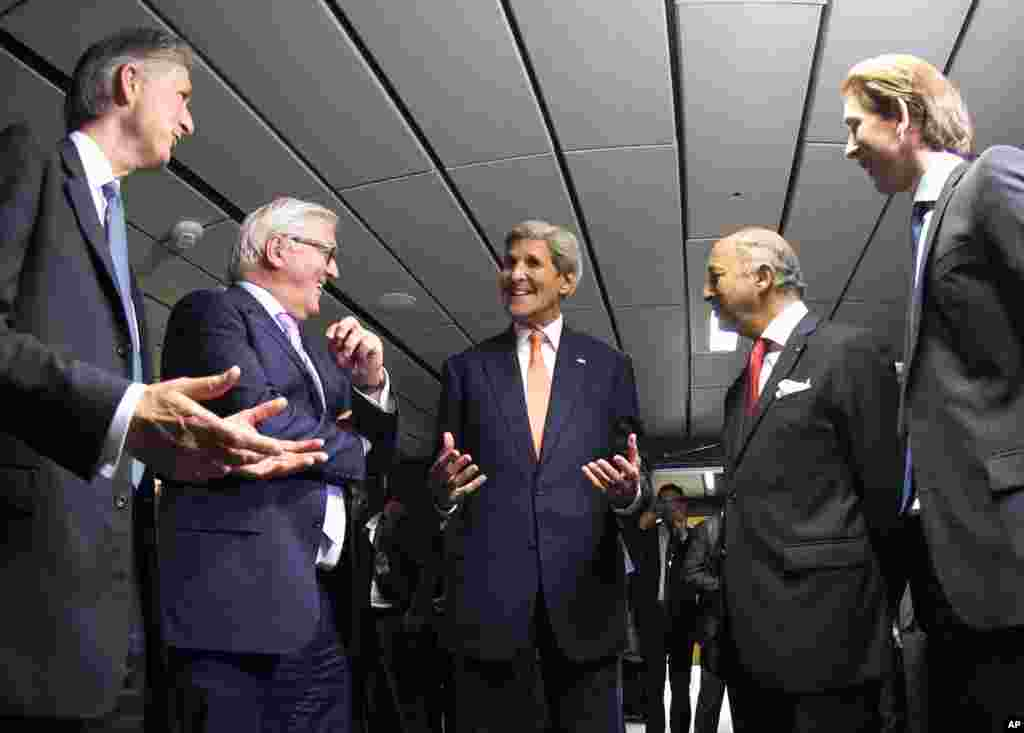 French Foreign Minister Laurent Fabius (2nd right), German Foreign Minister Frank-Walter Steinmeier (2nd left), British Foreign Secretary Philip Hammond (left), U.S. Secretary of State John Kerry (center), and Austrian Foreign Minister Sebastian Kurz (right) talk prior to their final plenary meeting at the United Nations building in Vienna, Austria, July 14, 2015.