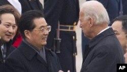 18 جنوری 2011ء کو امریکی صدر ہو جن تاؤ کی امریکہ آمد پر نائب صدر جو بائیڈن سے ملاقات ۔ فائل فوٹو