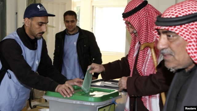 A man casts his ballot at a polling station in Amman, January 23, 2013.