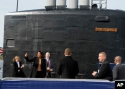 First lady Michelle Obama gives the thumbs up at the end of a commissioning ceremony for the U.S. Navy attack submarine USS Illinois, in Groton, Conn., Oct. 26, 2016. The submarine is named for Obama's home state of Illinois and the first lady is the ship