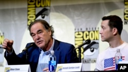 "Director/writer Oliver Stone, left, and actor Joseph Gordon-Levitt discuss the film ""Snowden"" on the opening day of Comic-Con International in San Diego, California, July 21, 2016."