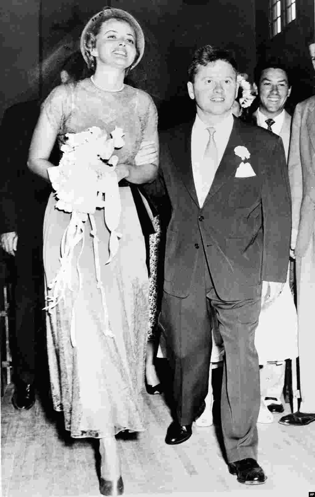 Actor Mickey Rooney and his bride, actress Martha Vickers, smile happily as they walk down the aisle of a church shortly after their wedding ceremony, in North Hollywood, California, June 3, 1949.