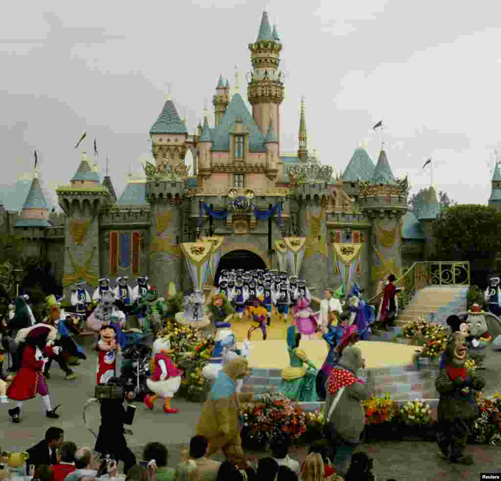 "The stage is filled with Disney characters during the finale at Disneyland's 50th anniversary celebration ceremony, at the Disneyland theme park as ""The Happiest Homecoming on Earth"" begins in Anaheim, California May 5, 2005. Sleeping Beauty Castle (backg"