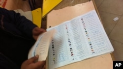 Ballots are readied on the second day of voting in Egypt's landmark parliamentary elections. Symbols make it easier for voters to recognize candidates, November 28, 2011 (file photo).