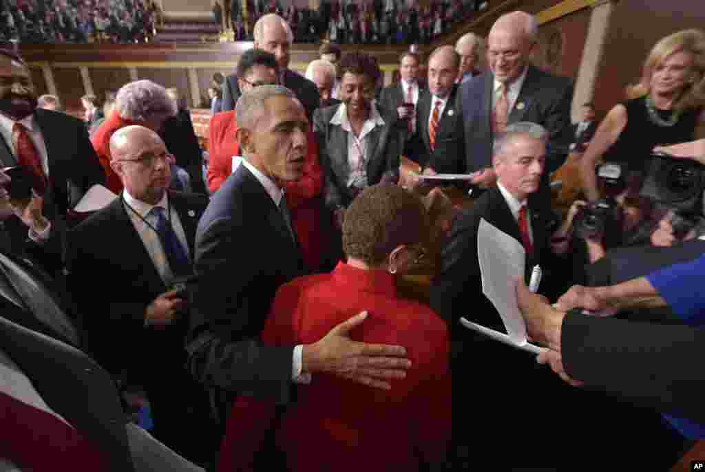 President Barack Obama greets members of Congress after delivering his State of the Union address, Jan. 20, 2015.