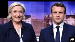 French presidential election candidate for the Front National party, Marine Le Pen, left, and French presidential election candidate for the En Marche! movement, Emmanuel Macron, appear before their debate Wednesday May 3. The two face each other in a run-off election on May 5.