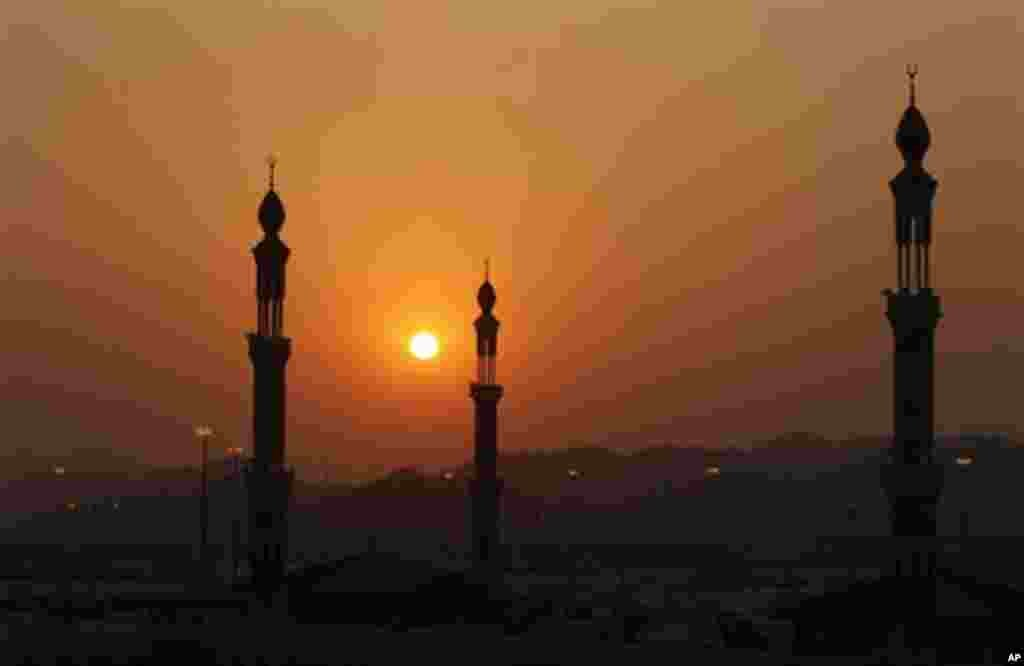 The minarets of Namira mosque are seen during prayers at sunset in Arafat near Mecca, Saudi Arabia, Monday, Nov. 15, 2010. The annual Islamic pilgrimage draws 2.5 million visitors each year, making it the largest yearly gathering of people in the world.