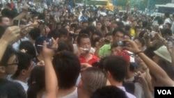 Demonstrasi yang dilakukan oleh warga di Guangzhou.