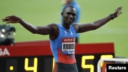 Kenya's David Rudisha celebrates after winning the men's 800 metres at the IAAF Diamond League athletics meeting, Saint-Denis, France, July 6, 2012.