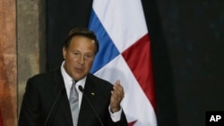 FILE - Panama's President Juan Carlos Varela speaks during a press conference in Mexico City, Mexico. Nov. 14, 2016.
