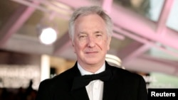 FILE - Actor Alan Rickman attends a tribute to actor Jeremy Irons as part of the 14th Marrakech International Film Festival in Morocco.