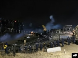 In this image provided by Morton County Sheriff's Department, law enforcement and protesters clash near the site of the Dakota Access pipeline, Nov. 20, 2016.