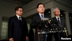 South Korea's National Security Office head Chung Eui-Yong, center, and National Intelligence Service chief Suh Hoon, left, make an announcement about North Korea and the Trump administration outside of the West Wing at the White House in Washington, March 8, 2018.