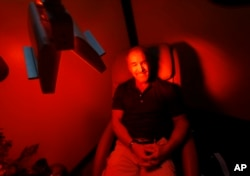 Ric Rooney sits in a newly installed room in his updated tanning salon northeast of downtown Colorado Springs, Colo., March 22, 2017. Former President Barack Obama's Affordable Care Act imposed a 10 percent tax on tanning as a way to help fund provisions of the law that expanded coverage for 20 million Americans.