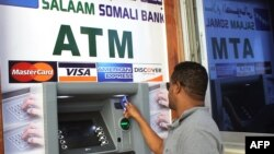Man uses first-ever ATM cash withdrawal machine in the country, Mogadishu, on Oct. 7, 2014.