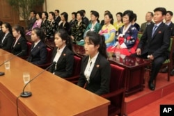 Colleagues and family members of 12 North Korean waitresses are presented to local and foreign media in Pyongyang, North Korea, May 3, 2016.