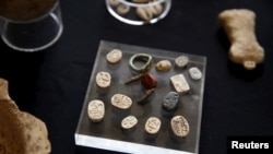 Ancient seal rings and seals typical of Egyptian culture, discovered during an archaeological excavation in a cave in southern Israel, are displayed at Rockefeller Archaeological Museum in Jerusalem April 1, 2015. A statement from the Israel Antiquities Authority (IAA) said artifacts found in the cave attest to the existence of an Egyptian administrative centre in the region 3,400 years ago.