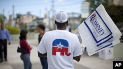 A man wears a shirt in support of Puerto Rican statehood before a campaign stop by Republican presidential candidate, former Massachusetts governor Mitt Romney on Saturday, March 17, 2012, in Bayamon, Puerto Rico.
