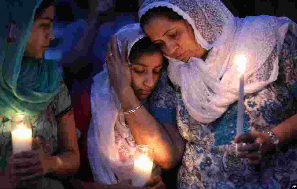 Worshipers in the Sikh community gather for a candle light vigil at the Sikh Religious Society in Brookfield, Wisconsin, August 6, 2012.