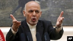 Afghan President Ashraf Ghani, speaks during, a press conference at the presidential palace in Kabul, Afghanistan.