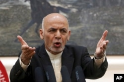 FILE - Afghan President Ashraf Ghani, speaks during a press conference at the presidential palace in Kabul, Afghanistan.