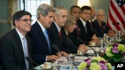 Treasury Secretary Jacob Lew, left, Secretary of State John Kerry, second from left, and others, participate in the Joint Session on Climate Change with Chinese delegation headed by Chinese Vice Premier Wang Yang, July 10, 2013.