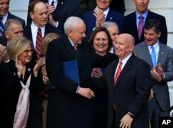 Chairman of the Senate Finance Committee Orrin Hatch (Front-L), Rep. Diane Black (Back-L), House Financial Services Committee Chairman Jeb Hensarling (Back-R), and other lawmakers applaud as House Ways and Means Committee Chairman Kevin Brady is acknowle