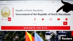 A girl points at word north at the official web site of Macedonian government with country new name Republic of North Macedonia in Skopje, Macedonia, Feb. 12, 2019.