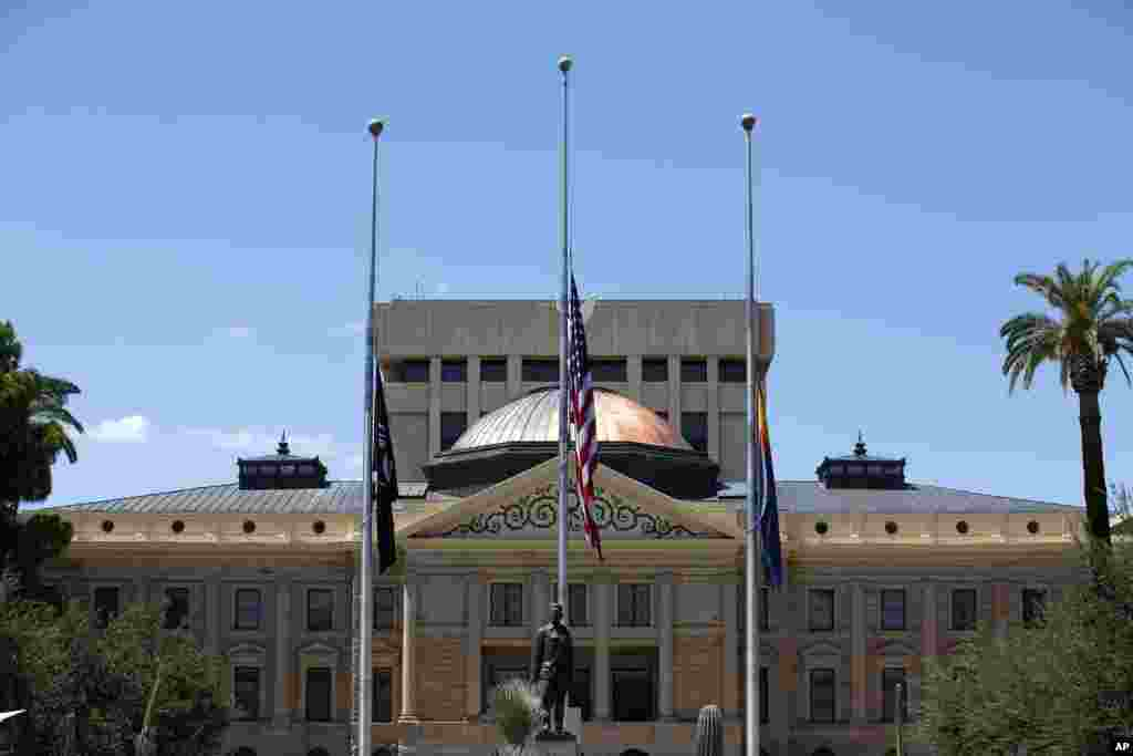 Flags fly at half-staff at the Arizona Capitol in memory of the late Arizona Republican Sen. John McCain, Aug. 26, 2018, in Phoenix.