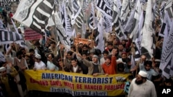Supporters of Hafiz Saeed, the leader of a banned Islamic group Jamaat-ud-Dawa, an alias of the Lashkar -e-Taiba terror group, rally against India and United States in Lahore, Pakistan in this Feb. 26, 2011 file photo.