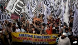 FILE - Supporters of Hafiz Saeed, the leader of a banned Islamic group Jamaat-ud-Dawa, an alias of the proscribed Lashkar-e-Taiba terror group, rally against India and the United States in Lahore, Pakistan, Feb. 26, 2011.