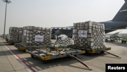 COVID-19 relief supplies from the U.S. are seen on the tarmac after being unloaded from a U.S. Air Force aircraft at the Indira Gandhi International Airport cargo terminal in New Delhi, India April 30, 2021.