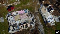 A house lays shattered, destroyed by Hurricane Dorian, in High Rock, Grand Bahama, Bahamas, Friday Sept. 6, 2019.