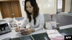Kina ankohet ndaj presioneve të ligjvënësve amerikanë për juanin
