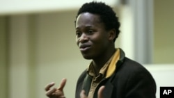 "Ishmael Beah, formerly of Sierra Leone and author of the book ""A Long Way Gone: Memoirs of a Boy Soldier,"" talks to the students and staff at Brunel University in London, January 30, 2008."