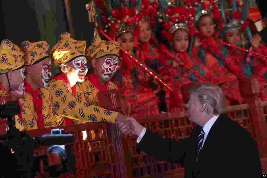 President Donald Trump meets opera performers at the Forbidden City in Beijing, China, Nov. 8, 2017.