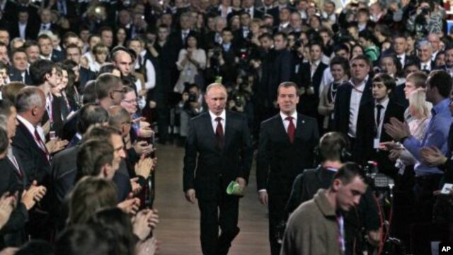 Russian President Dmitry Medvedev, right, and Prime Minister Vladimir Putin, left, seen as arrive at the United Russia party congress in Moscow, November 27, 2011.