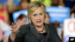 Democratic presidential candidate Hillary Clinton gestures as she speaks during a rally in Raleigh, N.C.