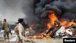 Hiện trường một trong những vụ tấn công bằng xe bom tự sát do Nhà nước Hồi giáo gây ra ở Iraq hồi tháng 3/2015.