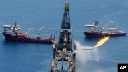 The Transocean Discoverer Enterprise drillship burns off gas collected at the BP Deepwater Horizon oil spill in the Gulf of Mexico off the coast of Louisiana, 25 June 2010