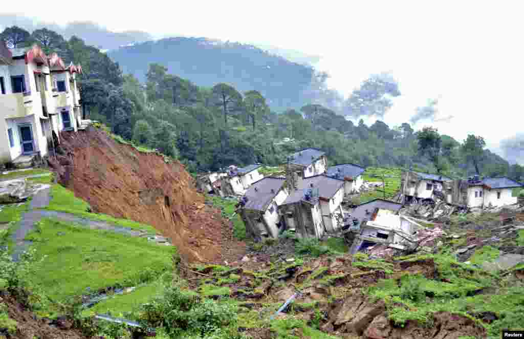 Damaged residential houses of the Indian army are seen after a landslide caused by heavy rains in Tihra Lines near the northern hill town of Dharamsala.