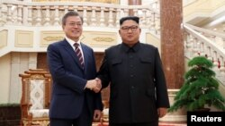 South Korean President Moon Jae-in shakes hands with North Korean leader Kim Jong Un as they arrive for their meeting at the headquarters of the Central Committee of the Workers' Party of Korea in Pyongyang, North Korea, September 18, 2018.