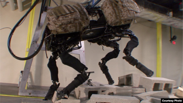 Boston Dynamics robot BigDog is seen climbing over a pile of rubble. The company was recently bought by tech giant Google for an undisclosed amount. (Boston Dynamics)