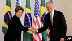 U.S. Vice President Joe Biden, right, shakes hands with Brazil's President Dilma Rousseff.