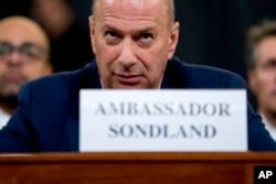 FILE - Gordon Sondland, U.S. ambassador to the EU, appears before the House Intelligence Committee on Capitol Hill, Nov. 20, 2019, during an impeachment hearing into President Donald Trump's actions.